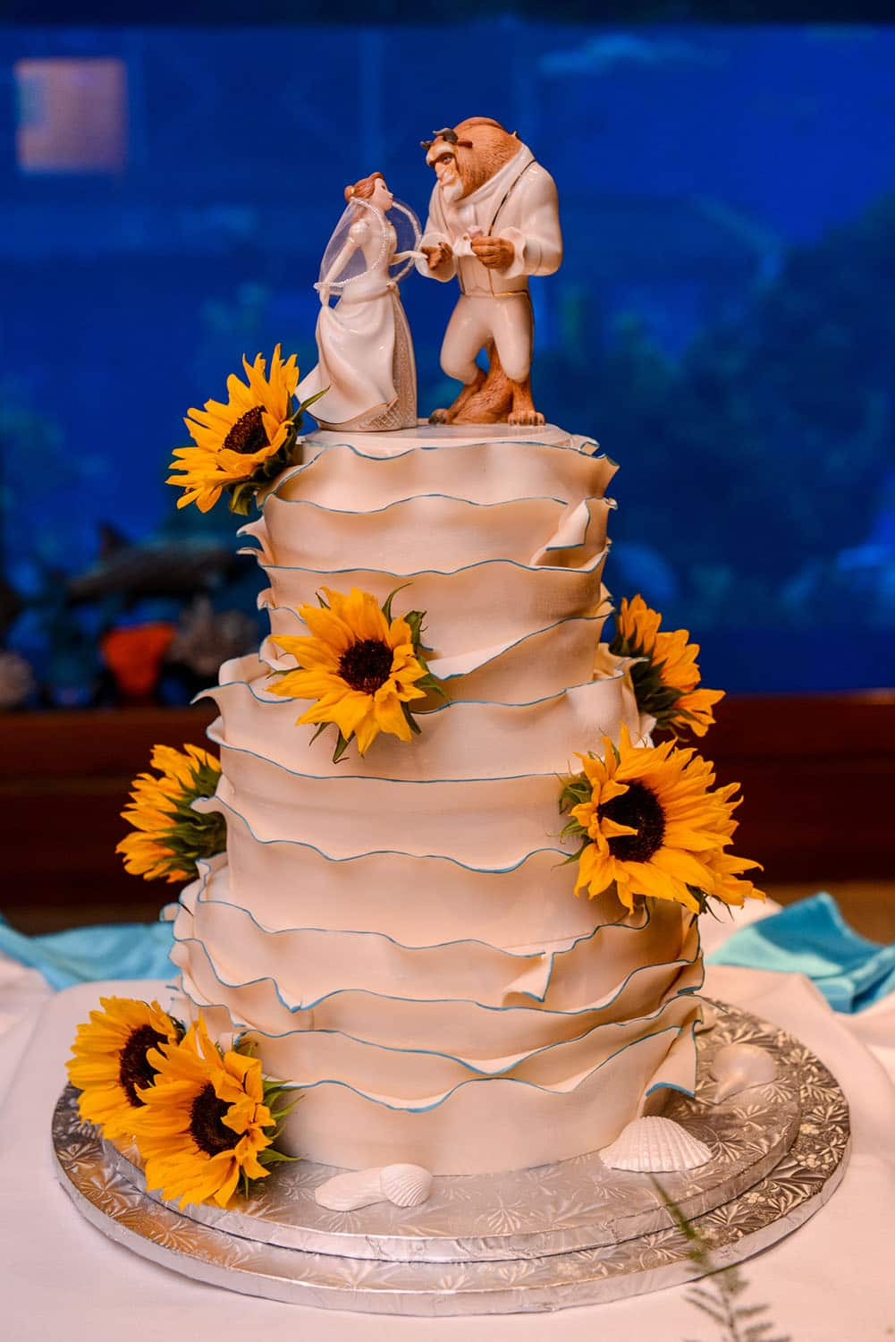 Topped With A Favorite Disney Belle And Beast Adorned In Their Own Wedding Attire We Invite You To Be Our Guest Enjoy This Delectable Dessert