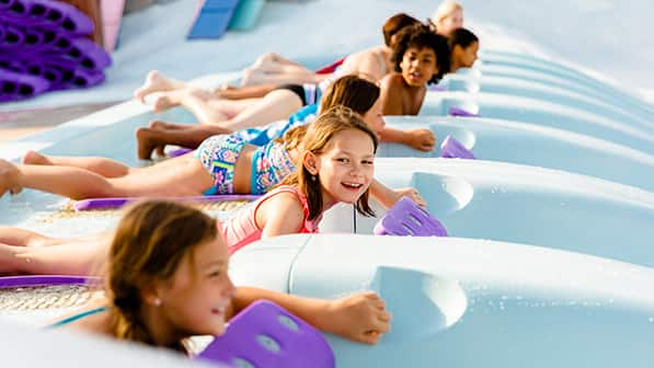 Children at the top of a water slide