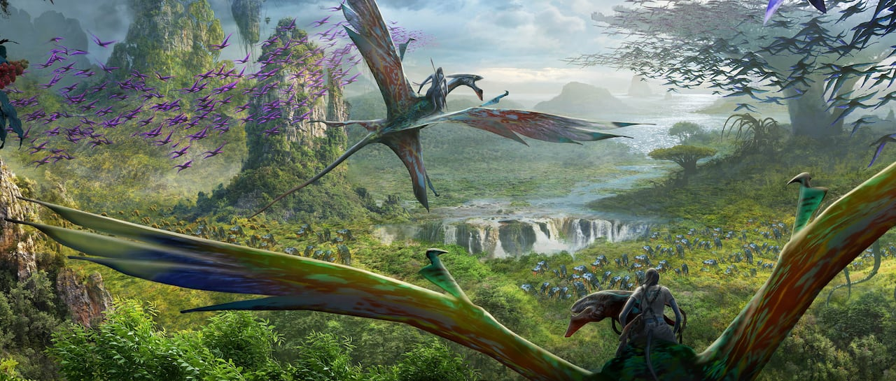 A duo of Na'vi people riding on the backs of mountain banshees soar over Pandora - The World of Avatar